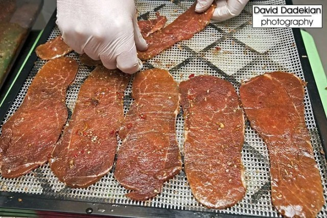 Slices of marinated pork tenderloin being prepared for the dehydrator to be turned into Chef Margate's delicious pork jerky (another highlight item)