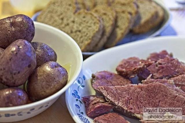 Dinner - potatoes (carrots & onions underneath), rye & soda breads, corned beef