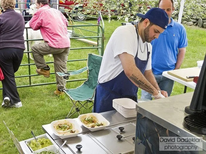 Chef Jake Rojas preparing tacos from the cart