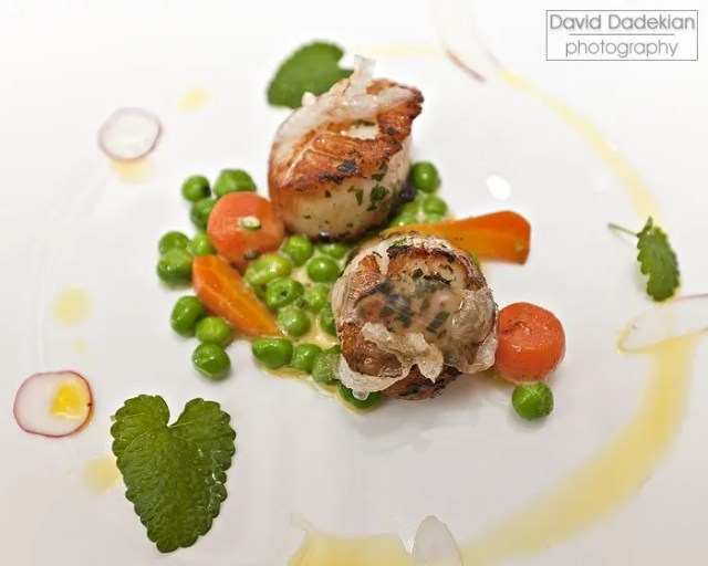 Butter-Roasted Native Bomster Sea Scallops with Lardo, Peas, Lemon-Chive Cream and Fresh Herbs