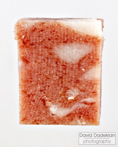 close-up exploration of a cube of mortadella