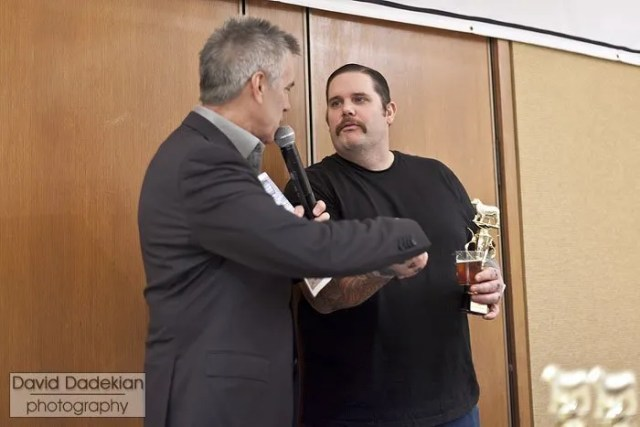 Chef Matt Jennings accepting the Best in Loin trophy from host Billy Costa