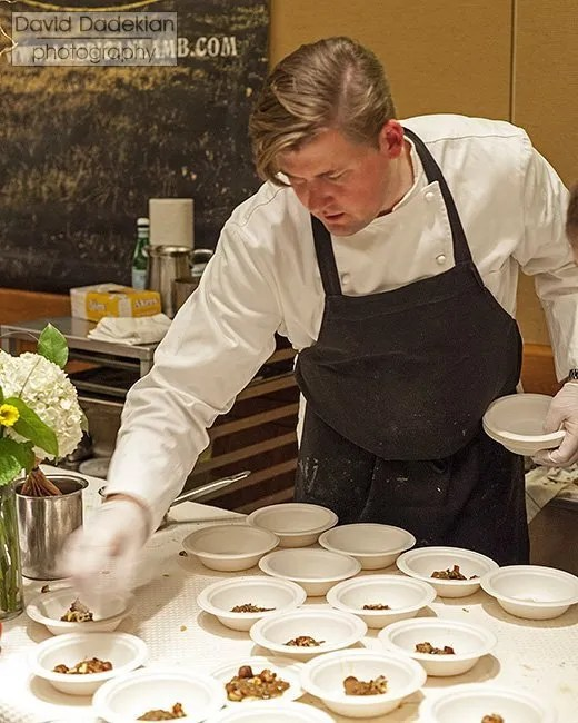 Chef Champe Speidel plating Slow Roasted Breast of Lamb with Medjool Dates, Pine Nuts, Cauliflower and Petite Anise Hyssop