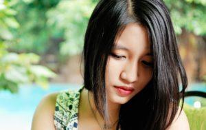 Asian American Woman or Girl Looking Down