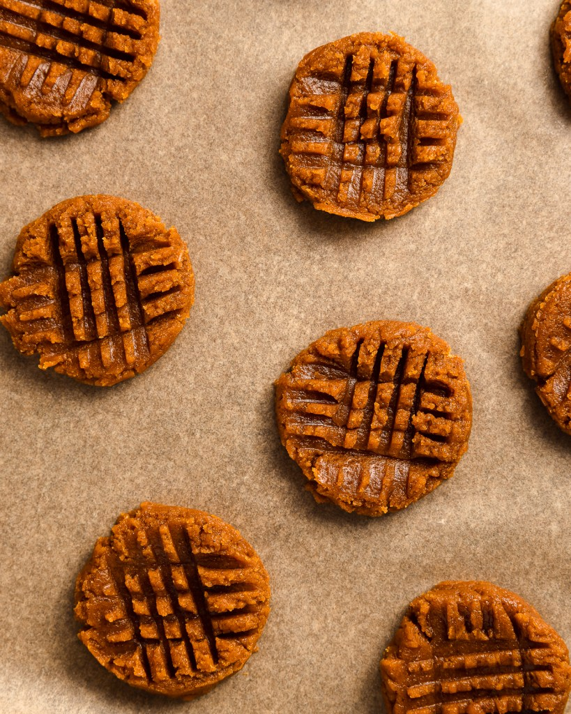 Peanut Butter Cookies laying on parchment paper