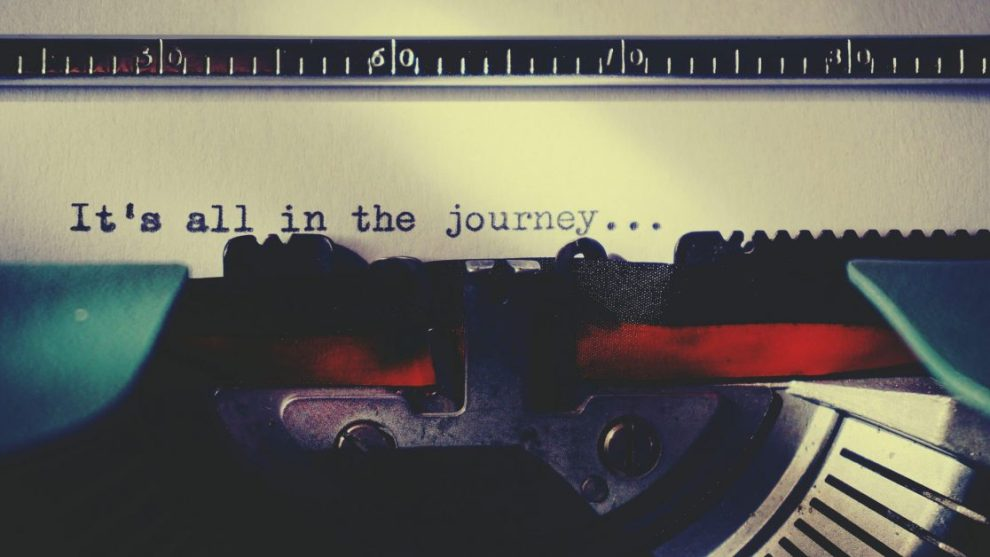 "Typewriter with ""it's all in the journey"" typed"