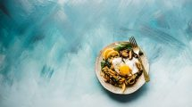 Pasta Dish on Brown Plate with Blue Background