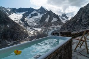 Yellow Toy Duck Floating in Pool in Snowy Mountains