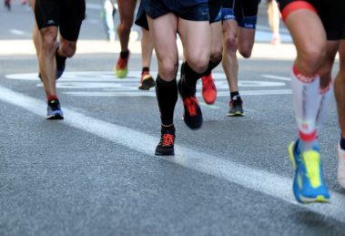 People Running on Grey Asphalt