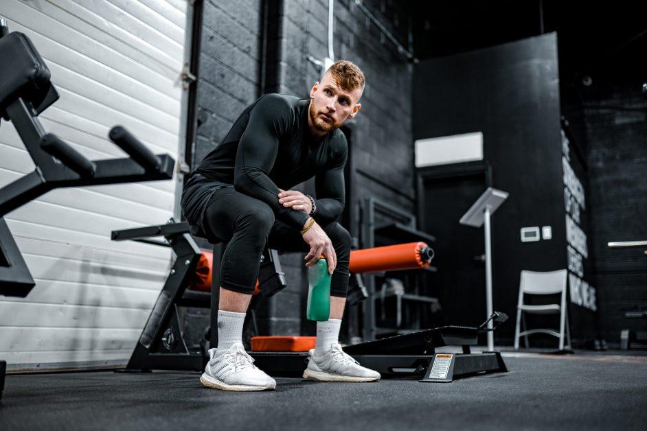 Guy Resting in Gym