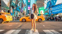 Woman Standing in Crosswalk in New York City with Traffic Behind