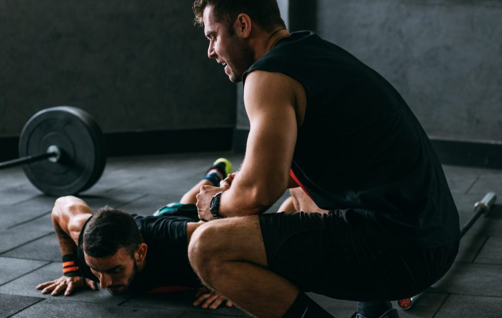Two Guys in Gym Doing Burpees Looking Tired