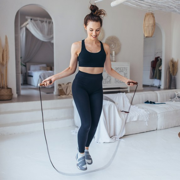 Girl Exercising With Jumping Rope At Home