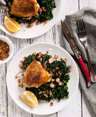 quick weeknight dinner crispy chicken thighs with kale and bacon