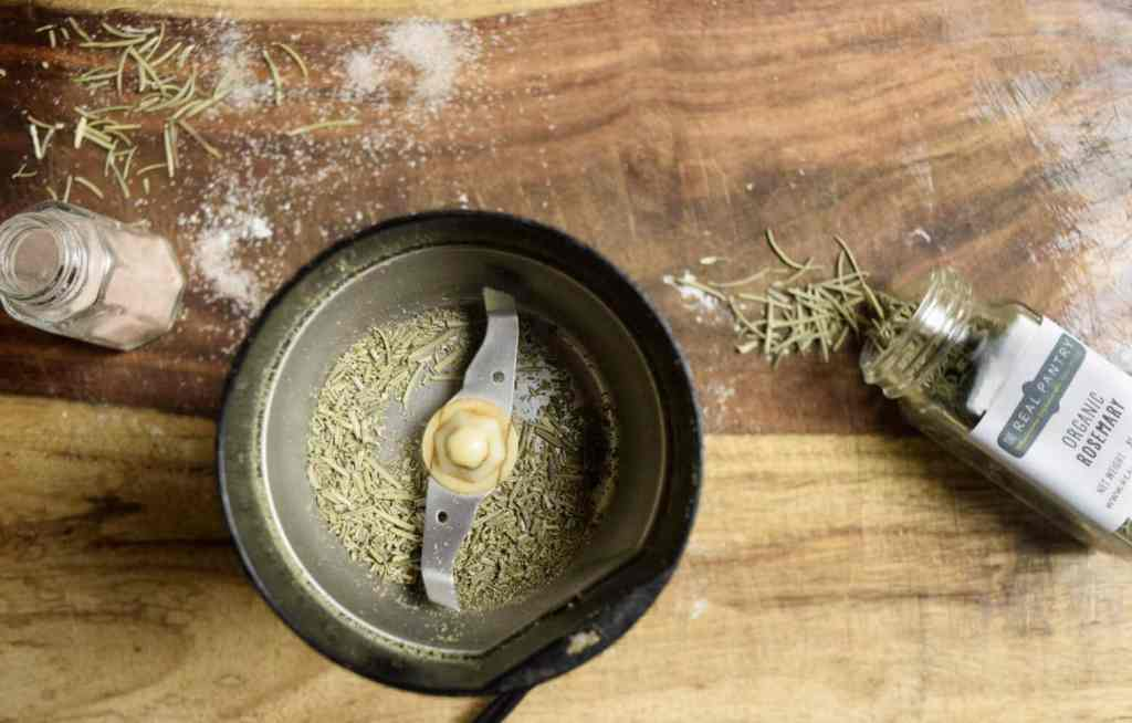grinding the rosemary