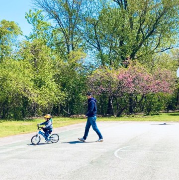 Kid biking with father