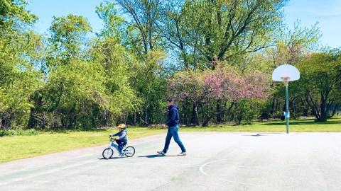 Kid biking with father