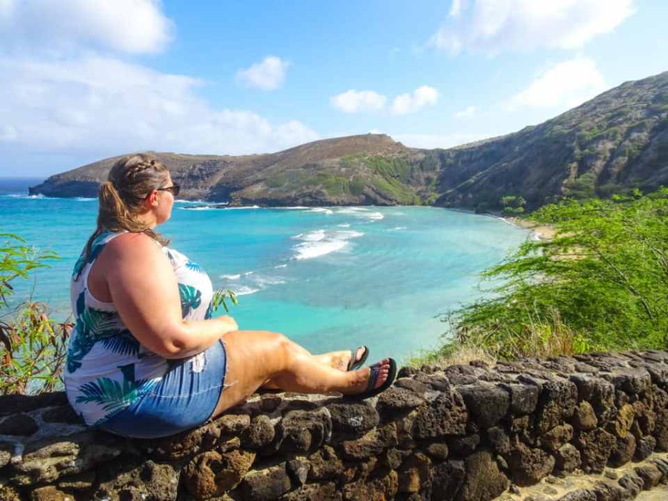 Sitting on the wall in Hanauma Bay, Hawaii