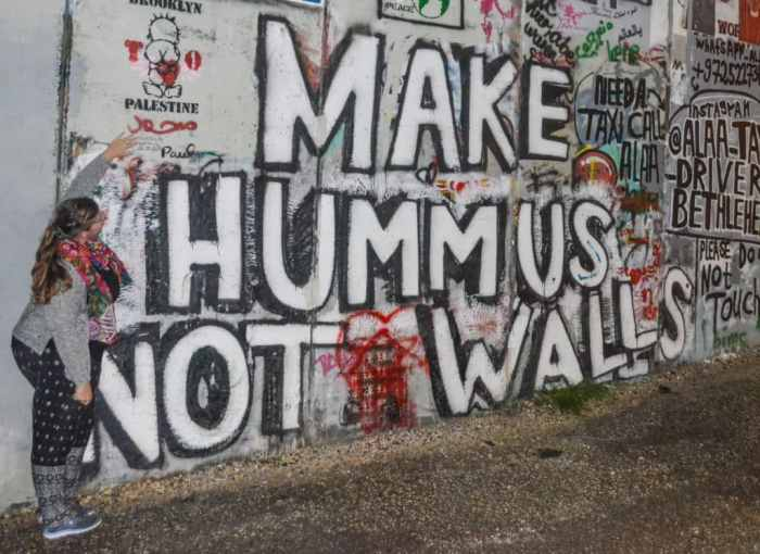 Make Hummus Not Walls street art in Bethlehem