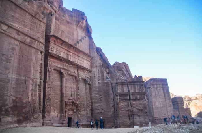 walking past the tombs in Petra