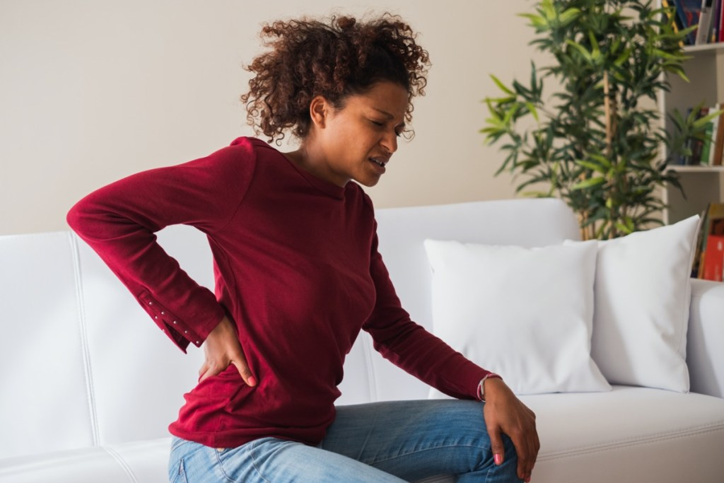 woman suffer back pain cramp