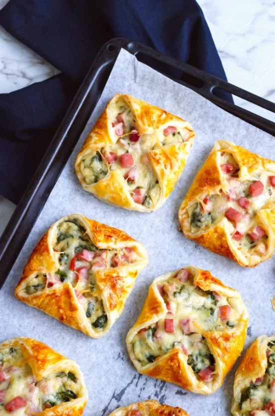 Ham Cheese Spinach Puff Pastry | These Easter brunch recipes are perfect for entertaining or enjoying a weekend brunch any time. You'll happily enjoy these creative brunch recipes on Easter morning. There's many sweet and savory brunch recipe to choose from the easiest french toast bake to a sourdough egg casserole and more. Here are 15 Easter Sunday brunch recipes to feed a crowd! #xokatierosario #easterbrunchrecipes #easterbrunch #easybrunchrecipes