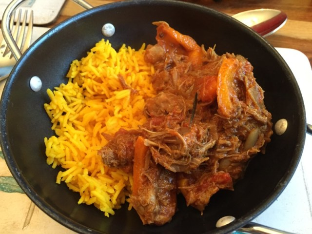 Homemade slow-cooked lamb neck curry with turmeric spiced rice