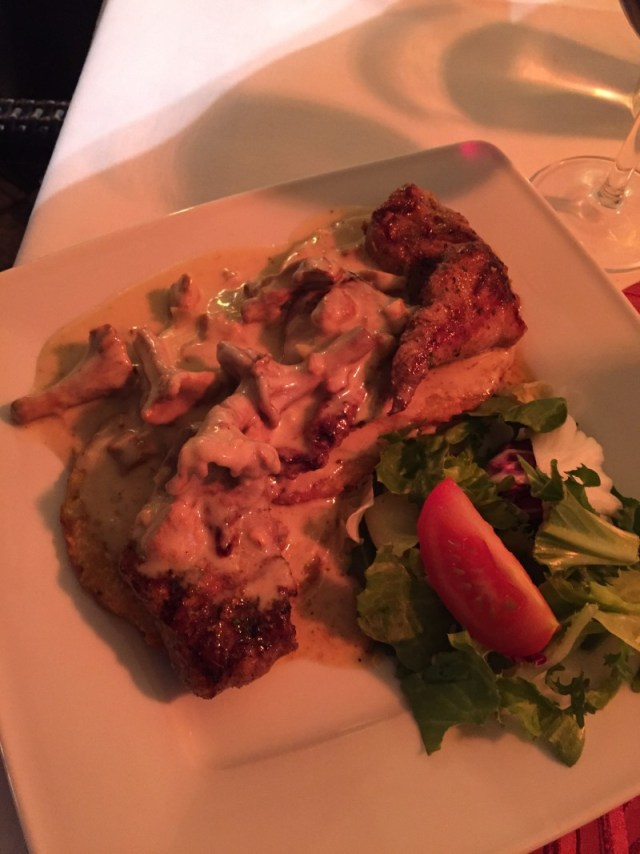 Veal with mushroom sauce and potato cakes in Krakow, Poland