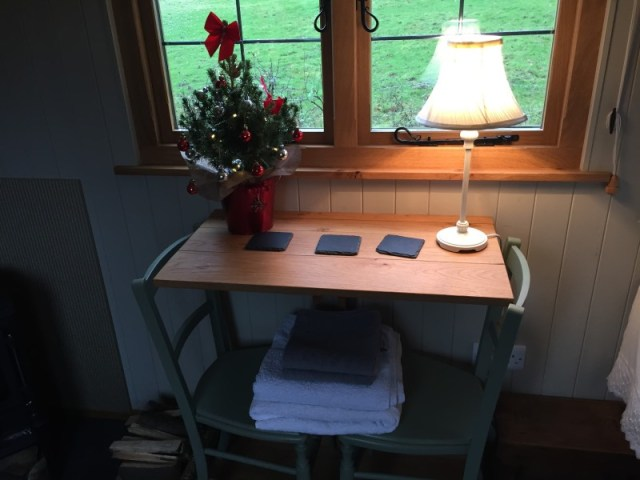 Table and chairs in the shepherds hut