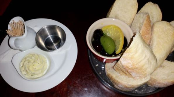Housemade fresh bread, herbed butter and marinated olives