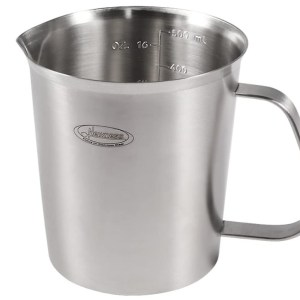 Measuring cup with spout
