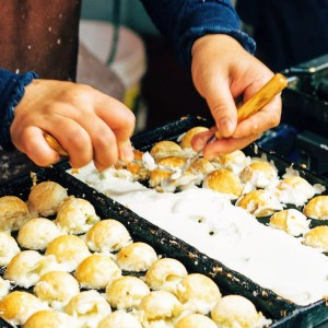 Takoyaki making - flipping