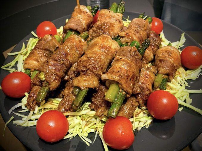 Thinly sliced pork wrapped around Asparagus