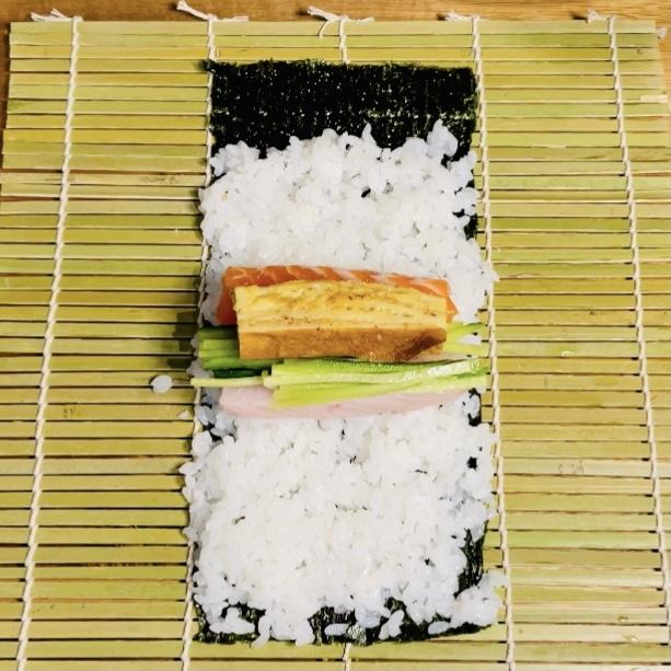 Salmon Albacore Japanese Egg Omlette Cucumbers on Sushi Rice on Nori Seaweed on Makisu - Sushi Roll - EATwithOHASHI.com