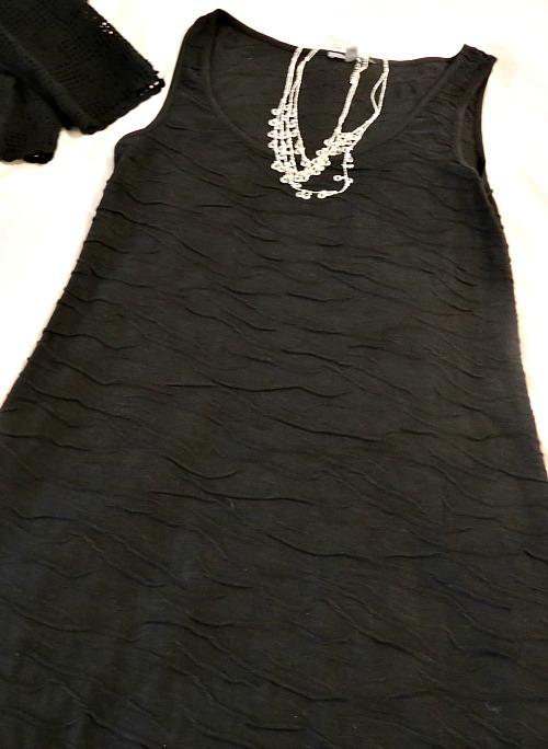 black dress w fancy necklace