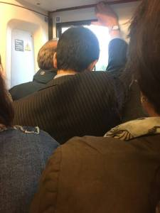 overcrowded commuter train