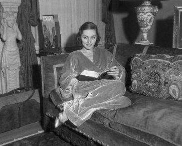 Adrienne Ames reading a book