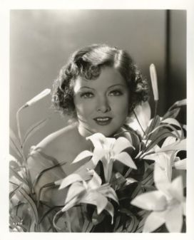 Myrna Loy with lilies