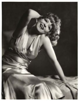 Clara Bow in satin gown