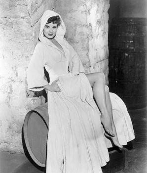 Jean Peters on a wine barrel