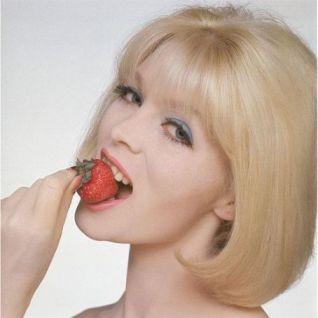Nico eating a strawberry