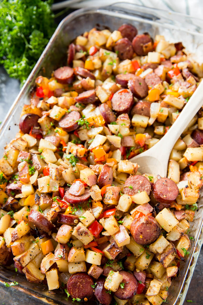 Baked Sausage, Potatoes, and Peppers: A hearty and filling side dish, full meal, breakfast hash, with plenty of flavor. This Potato, Pepper, and Sausage Bake is perfect for grilling season too!
