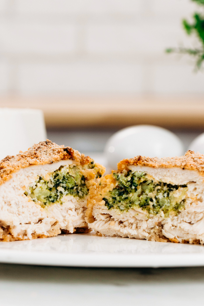 Broccoli Cheese Stuffed Chicken Breasts on a white plate with a panko breading