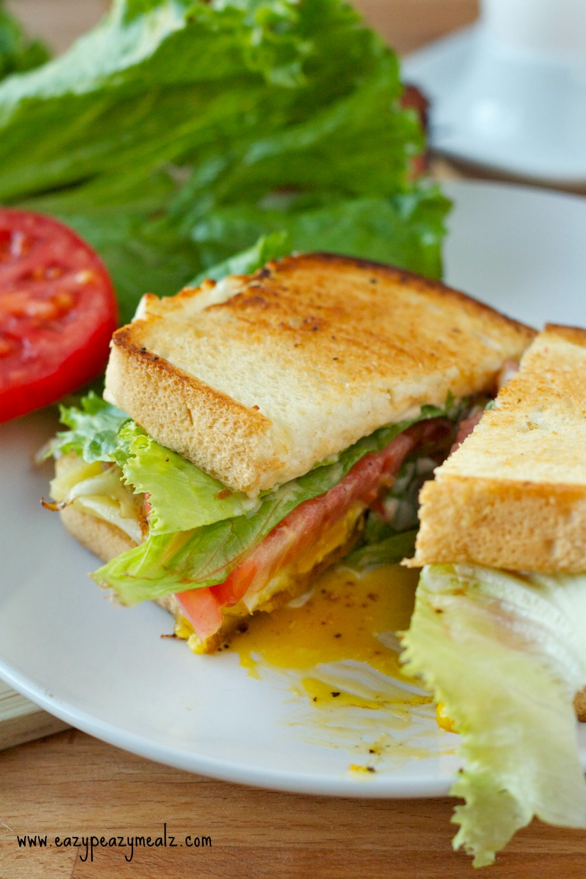 BLT sandwich on a white plate