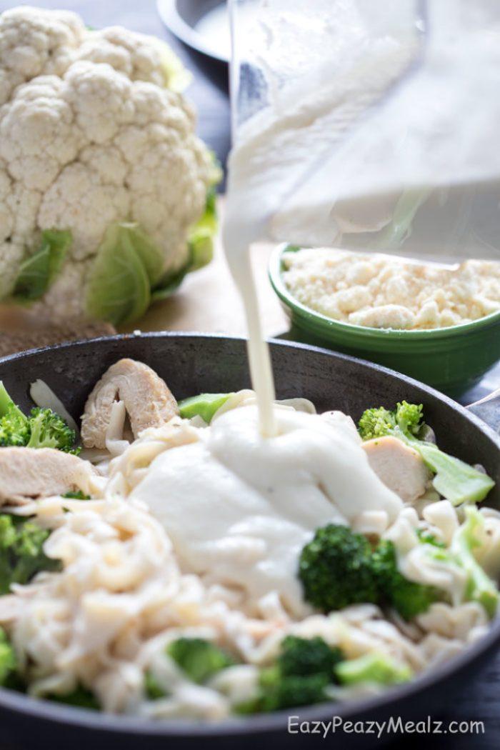 pouring-sauce-cauliflower