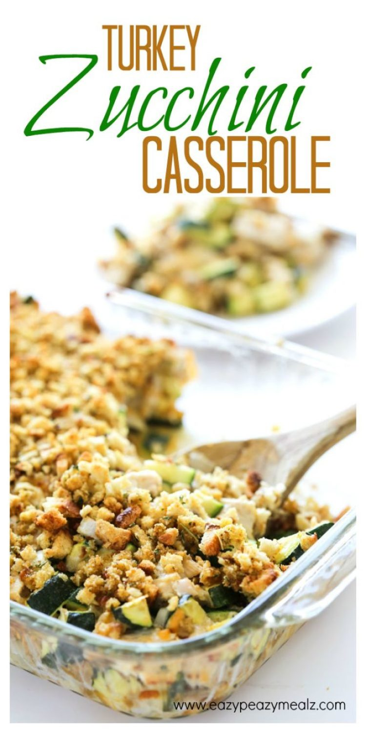 Cheesy Turkey Zucchini Casserole: Fresh baked casserole in a glass dish with a wooden spoon in it.