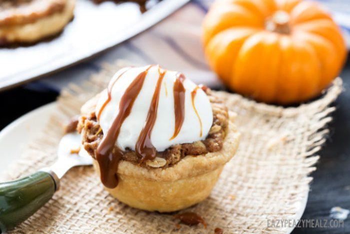 Oatmeal Caramel Crumble atop of a mini muffin tin pumpkin pie