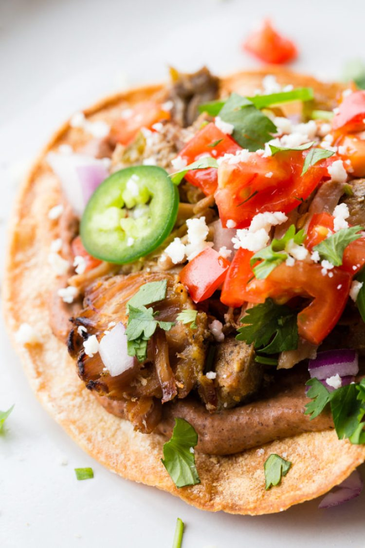 These carnitas tostadas are crispy, with black beans, the best carnitas, and all your favorite toppings.