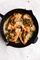 Creamy Tuscan Chicken, cooked in a skillet.