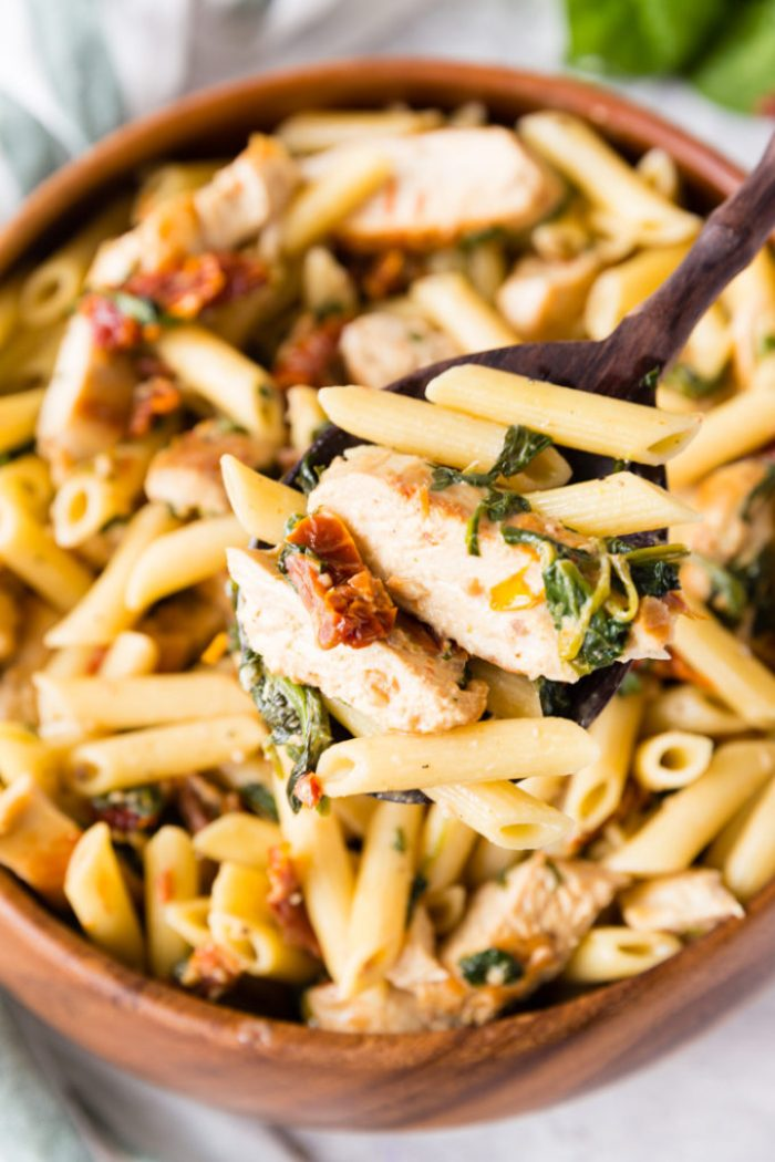 A delicious scoop of creamy tuscan chicken penne pasta